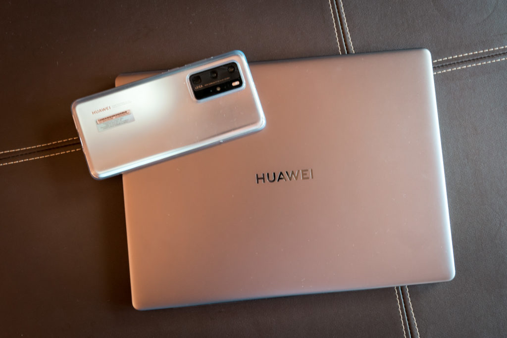flatlay showcasing both the huawei p40 pro smartphone and huawei matebook 13 2020
