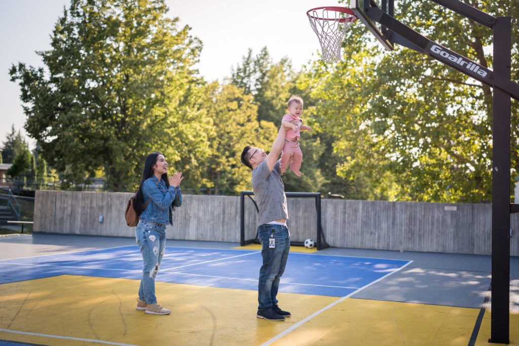 Glamouraspirit and family at RMHBC playing basket ball at basket ball court in vancouver building