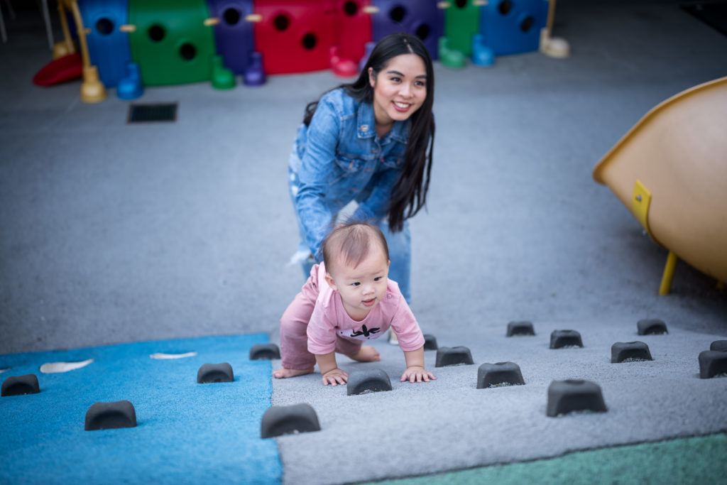 Adelina playing rock climbing at RMHBC in Vancouver building