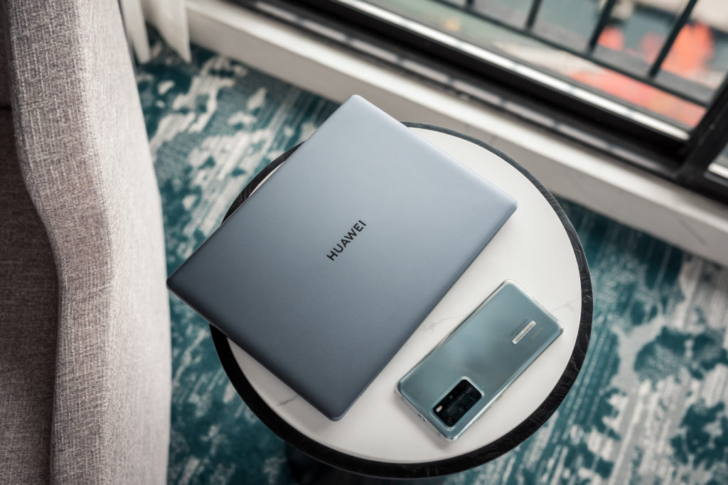 Huawei P40 Pro in Silver frost and Matebook 13 flatlay at Westin Bayshore Vancouver hotel
