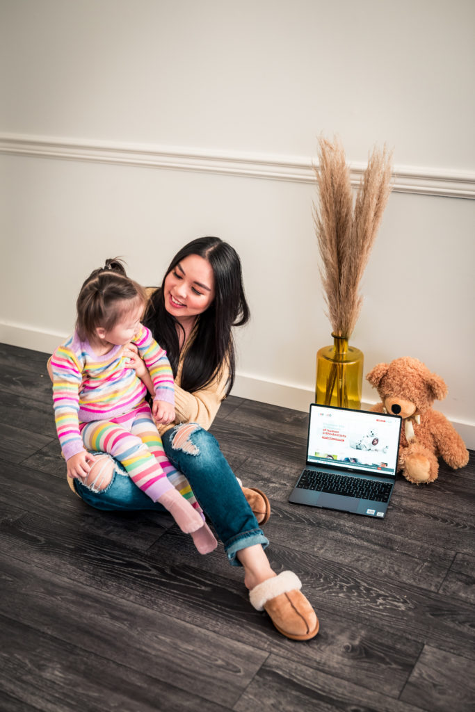 Glamouraspirit with daughter laptop showing website of C.A.O and teddy bear